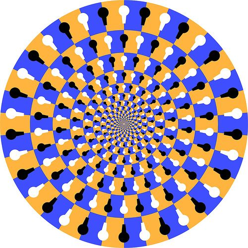 If you stare directly at the image it stops spinning ...