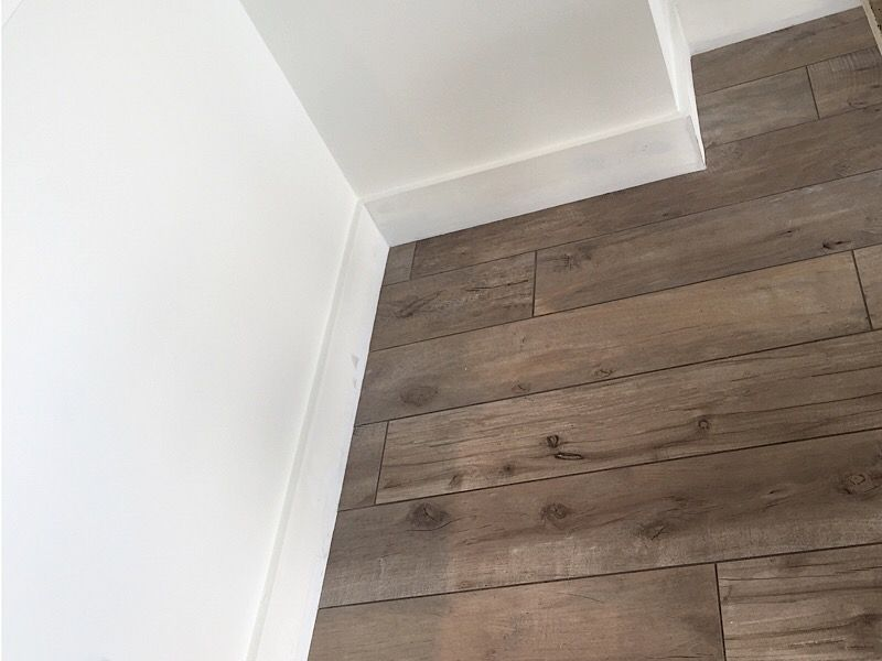 Staggered Wood Look Tile Looks More Like Wood Because The Grout Joints Appear As Spaces In The Wood Wood Look Tile Apartment Design Wood Design