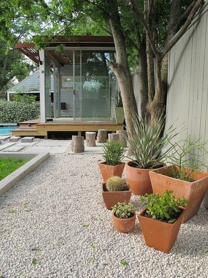 garden design with gravel and pot