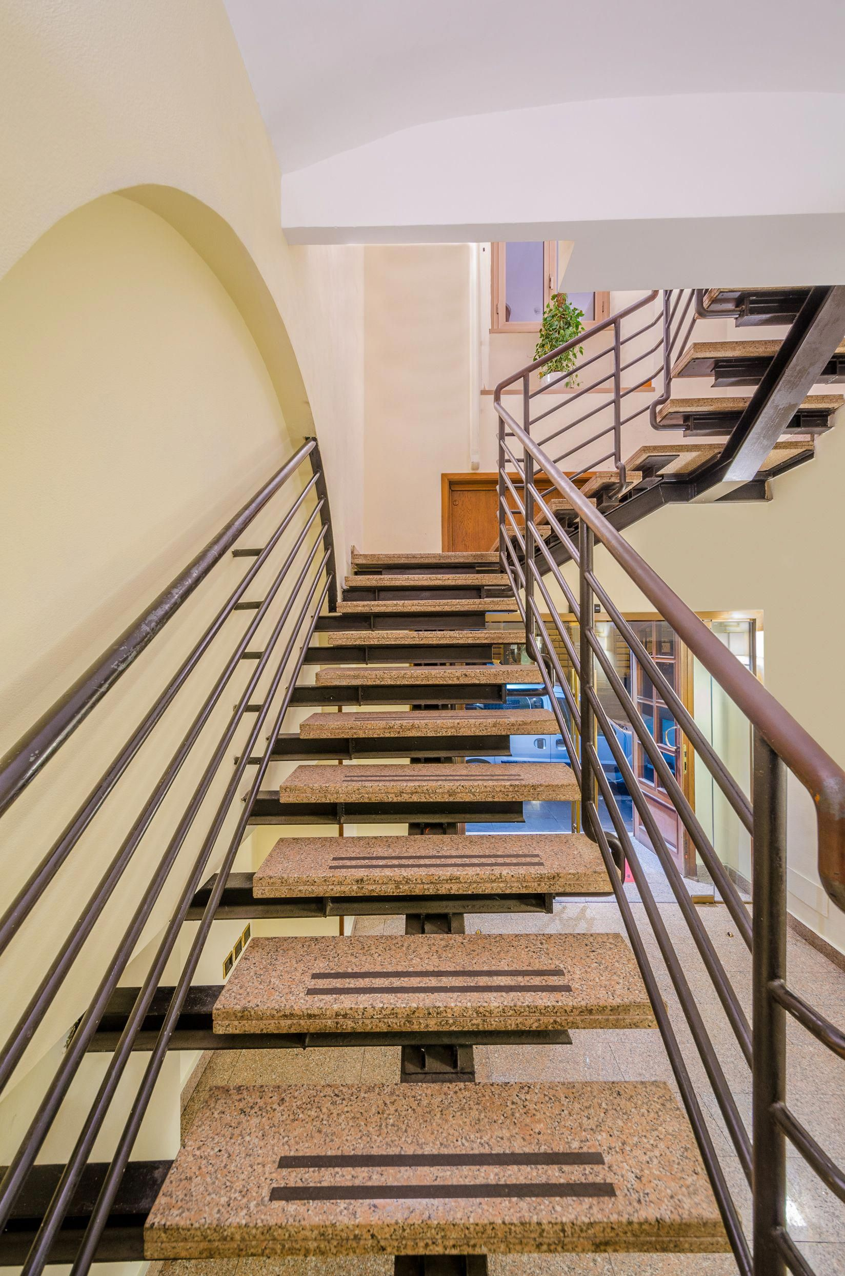 Modern Staircase With Metal Baluster And Single Spine Stringer