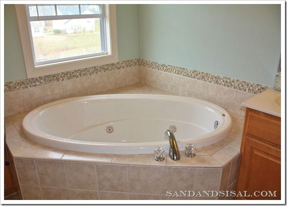Add a stone and glass tile border. I'm thinking I will do this in my master bathroom.