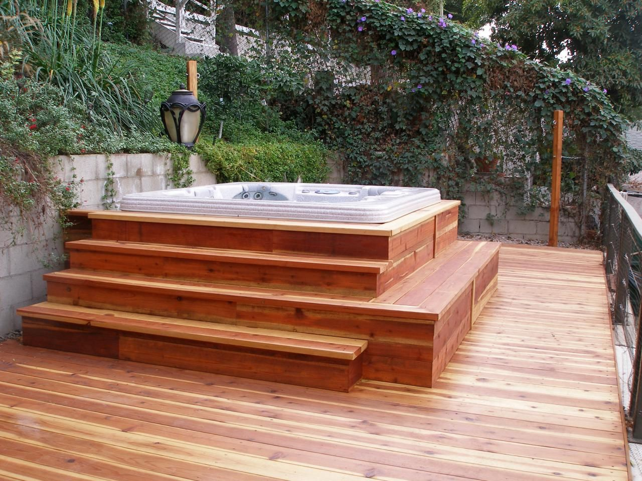 Corner Deck Hot Tub With Small Pergola And Vertical Privacy Fence