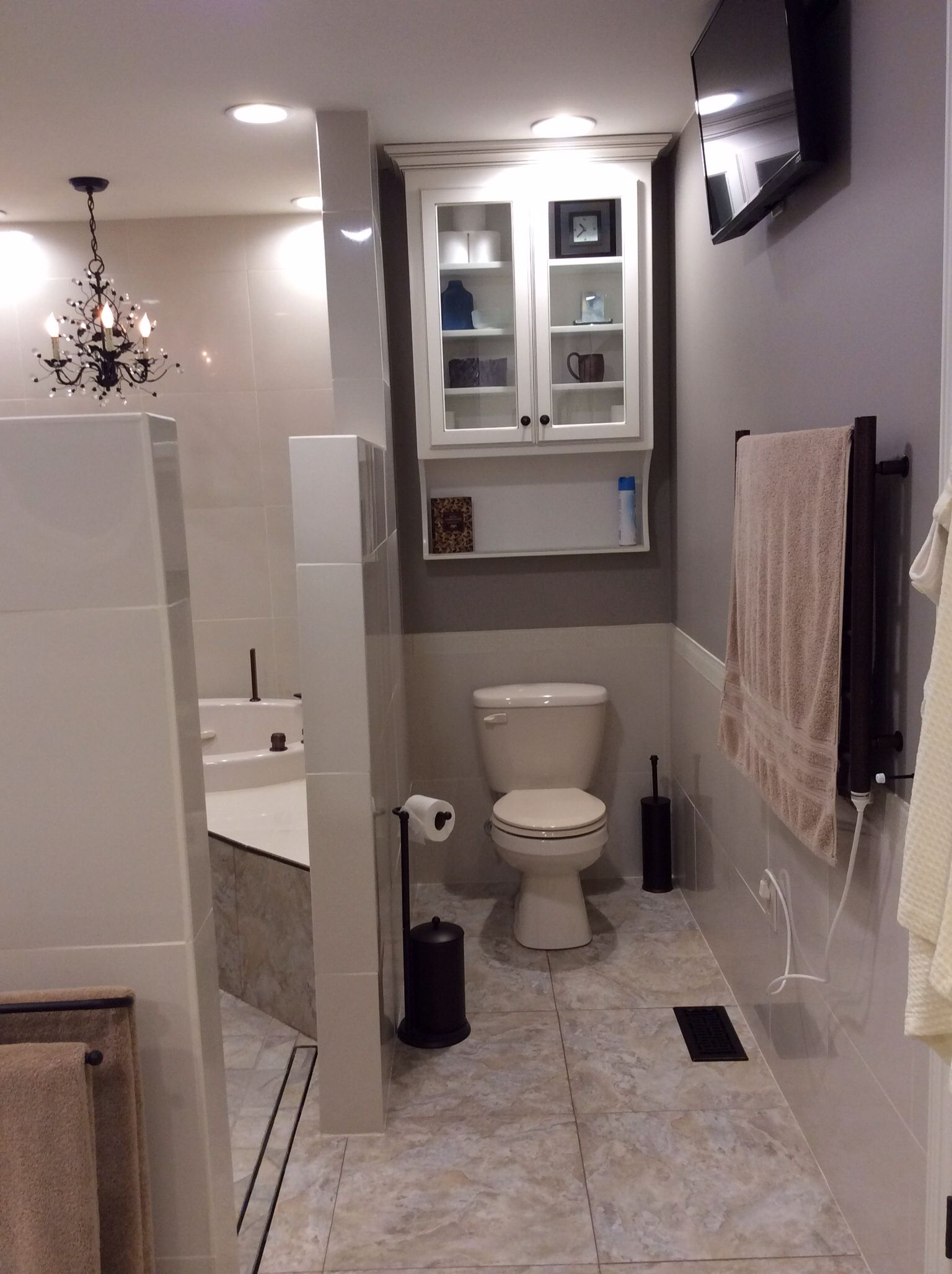 Remodeled bath -TV above towel warmer can be viewed while in shower ...