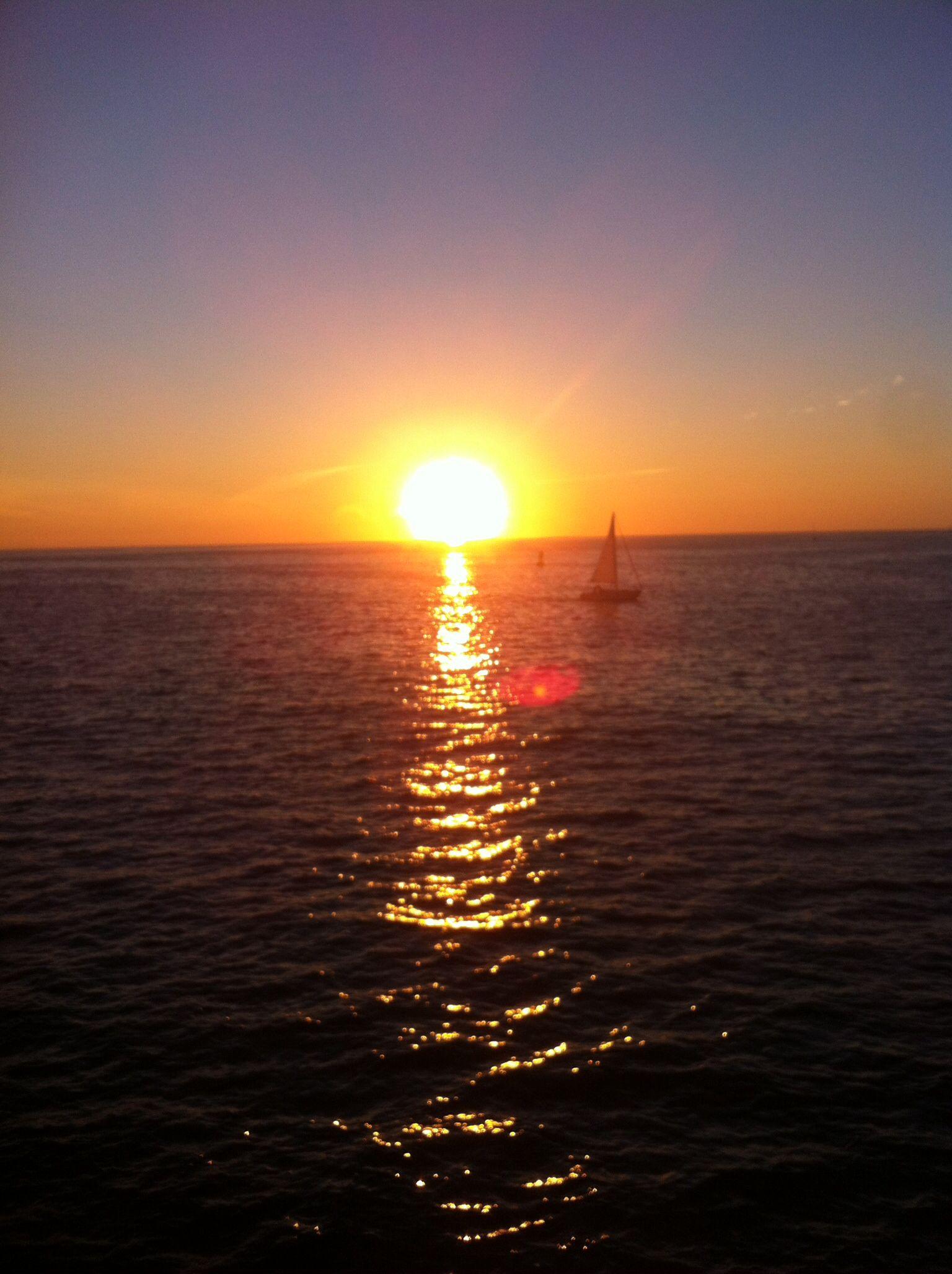 Redondo Beach, California. Sunset and Sailboat.