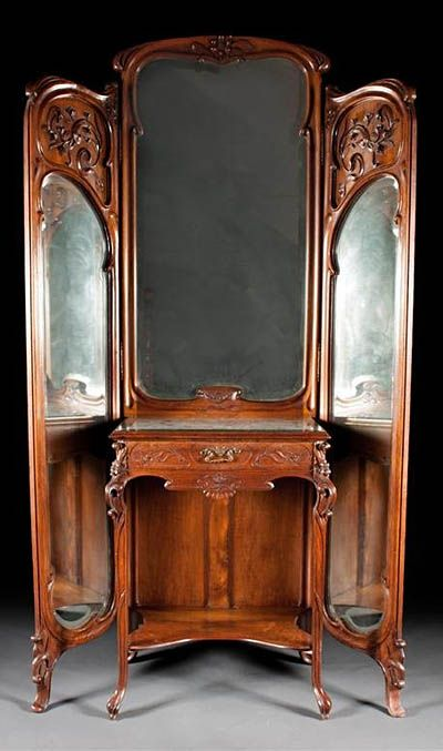 Very fine, French, Art Nouveau period, trifold mirror with vanity: In solid, carved walnut.  In the manner of Majorelle.  Circa 1900.