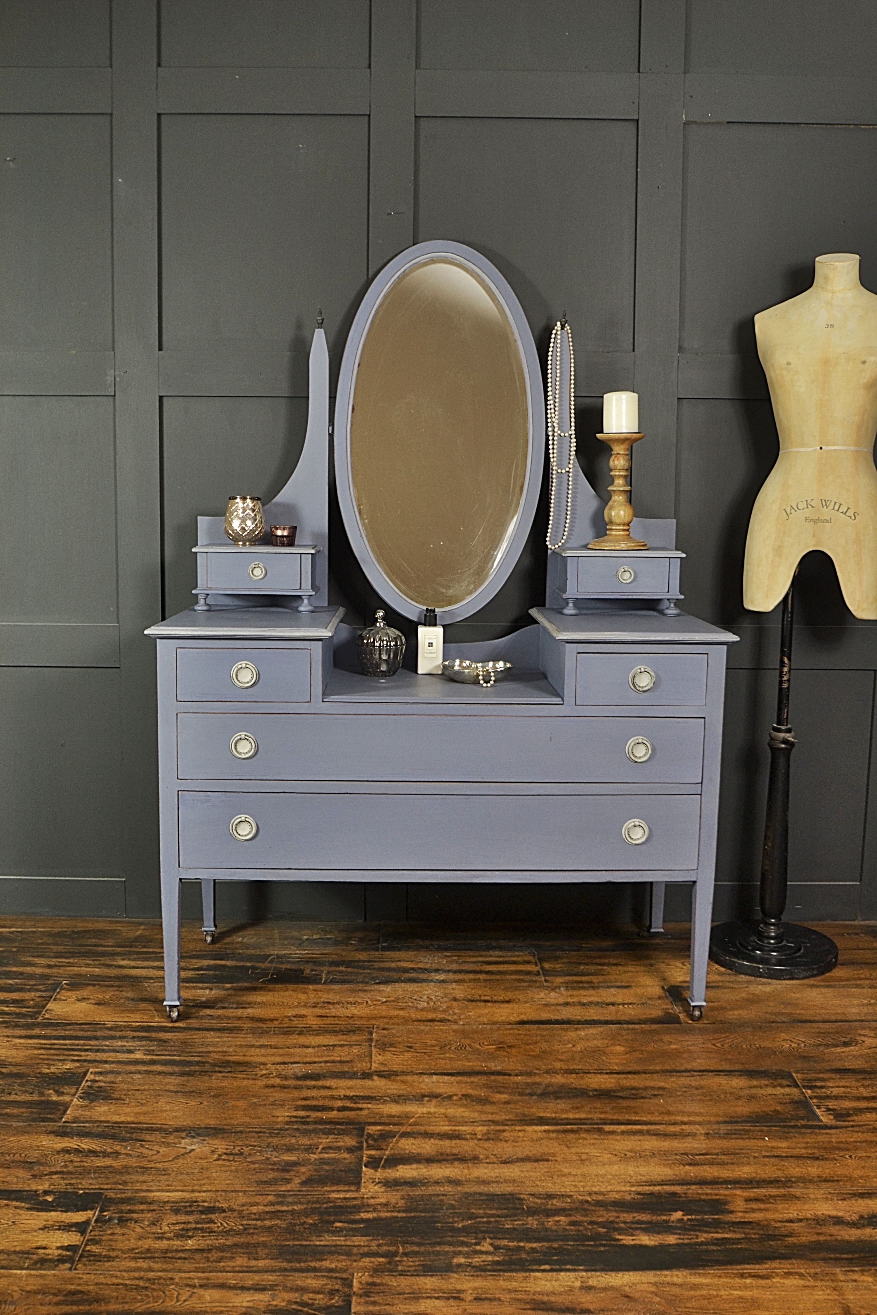 This edwardian dressing table on castors has a large oval mirror and
