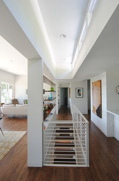 Staircase In Middle Of Room Wrap Around And Matching Materials | Basement Stairs In Middle Of Kitchen | Open Plan | Square Shaped | Finished | Galley | Ranch