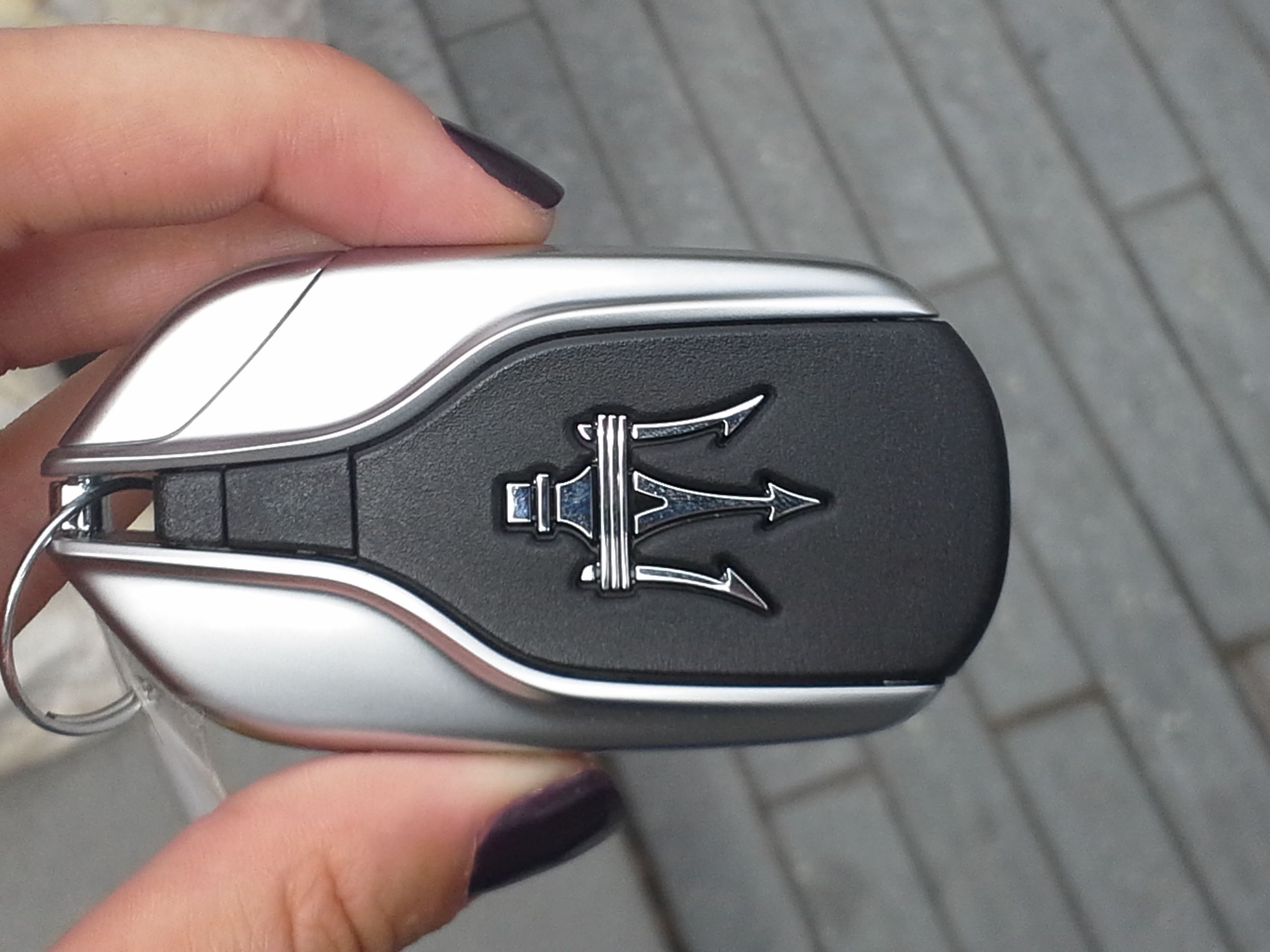 Me holding the Maserati key and thinking of committing ...