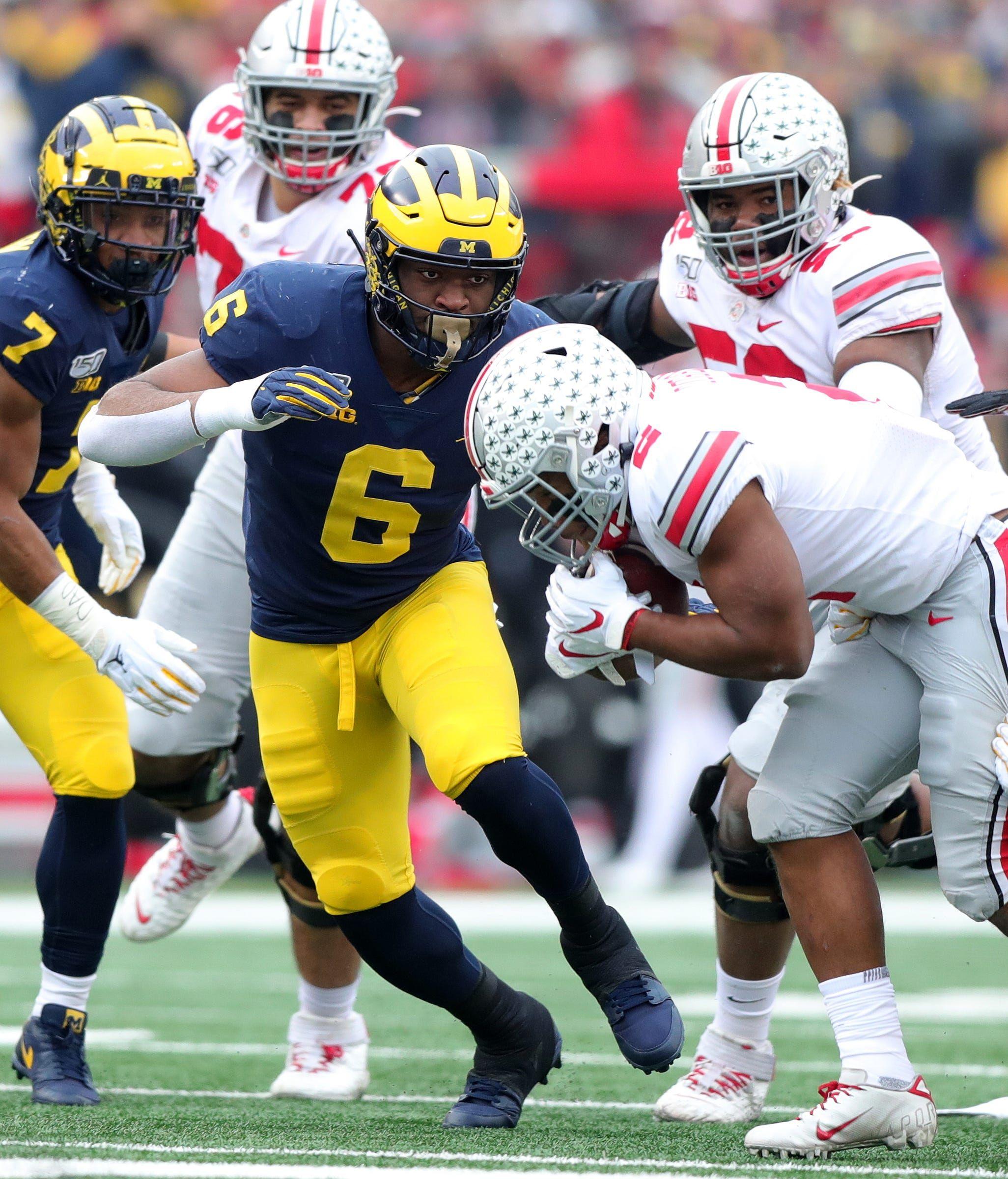Michigan football's star passrusher Josh Uche heading to