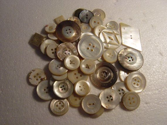 large collection of mother of pearl buttons by alomartesantiques