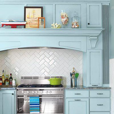 Kitchen Backsplash Diagonal Pattern plain white ceramic tiles are set in a diagonal herringbone