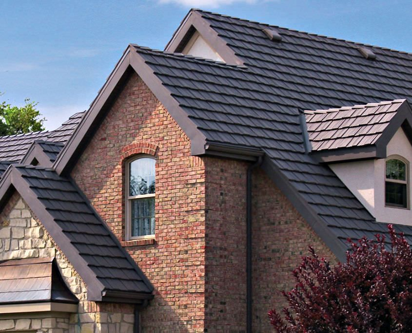 Cedar Metal Shingles Photos 2 Story House Metal Shake Roofing System Deep Charcoal Colour Brick An Metal Shingle Roof Metal Roof Houses Metal Roofing Systems
