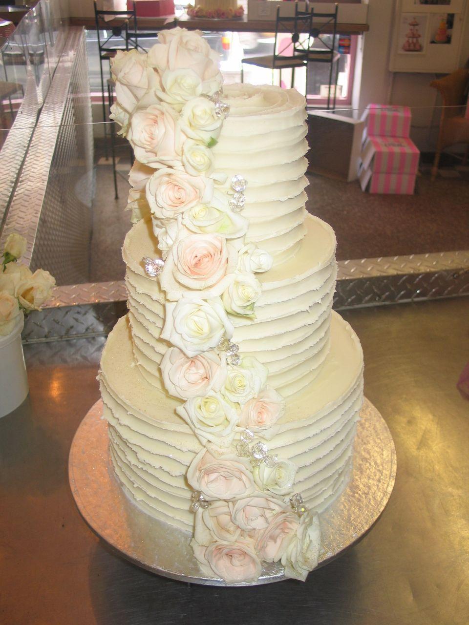 3 tier white chocolate wedding cake with white & cream roses ...