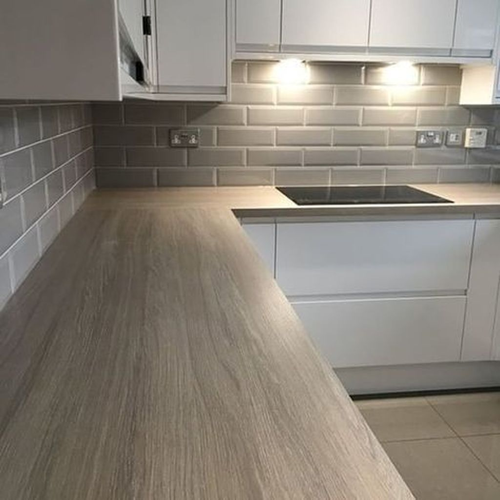White Gloss Kitchen With Grey Marble Worktop
