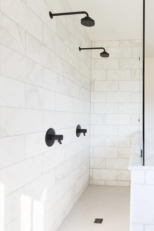 Stunning long shower clad in honed white marble wall tiles boasts ...