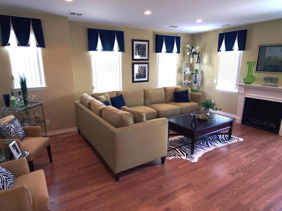 bold indigo window treatments and a zebra print rug