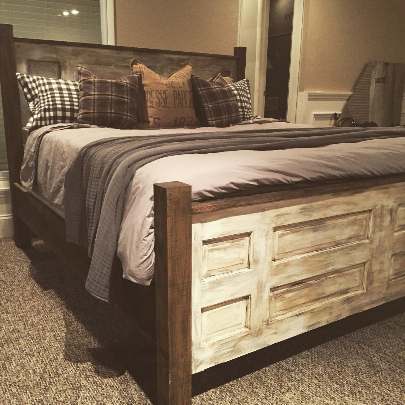 Old doors barn wood turned into a king bed bed ideas pinterest