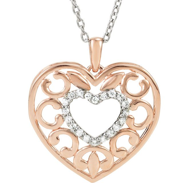 """This necklace is made in Sterling silver with a rose gold plated filigree heart with 1/10ctw. of I2 H diamonds set in the center. Included is a 18"""" sterling silver rolo chain. $179.00  http://www.dbof.com/jewelry/diamond-heart-silver-and-rose-gold-plated-necklace/"""