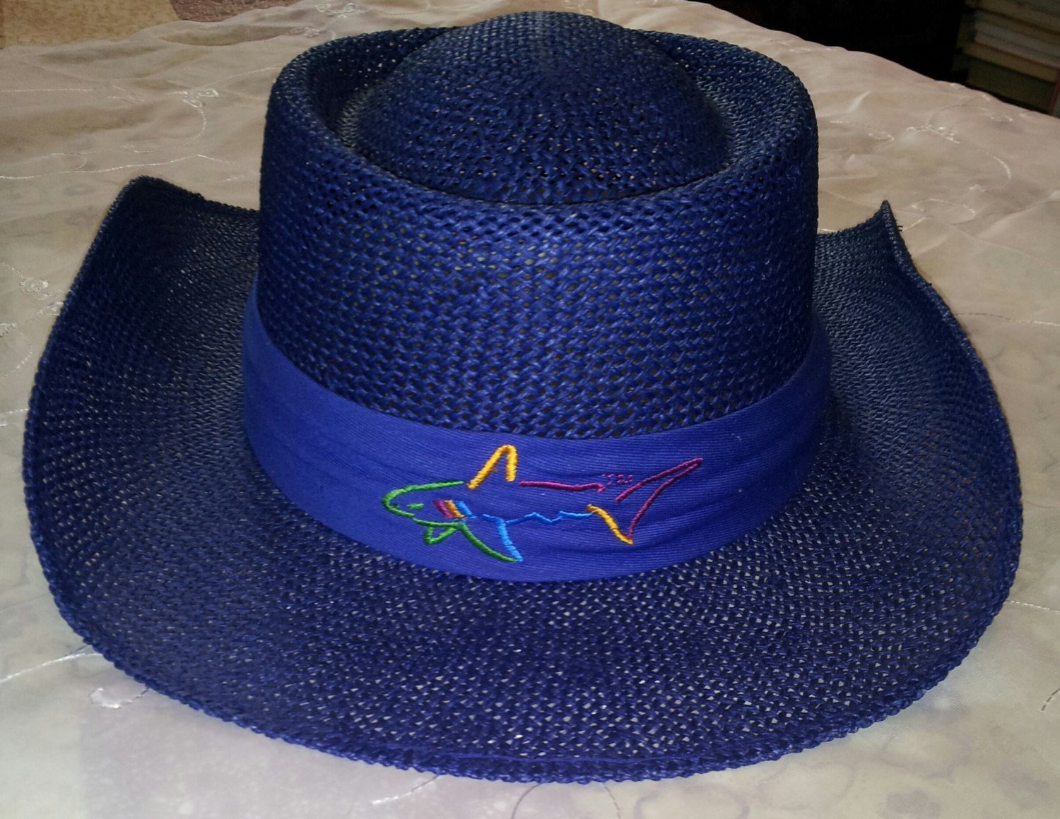One Of A Kind Navy Blue Colored Straw Hat Worn By Greg Norman In A Reebok Shoot He Is Known To Only Wear Black Beige Or Wearing Black Beige Navy Blue