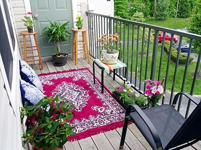Apartment Patio Balcony Decorating It S Amazing What A Difference An Outdoor Rug Flowers Make