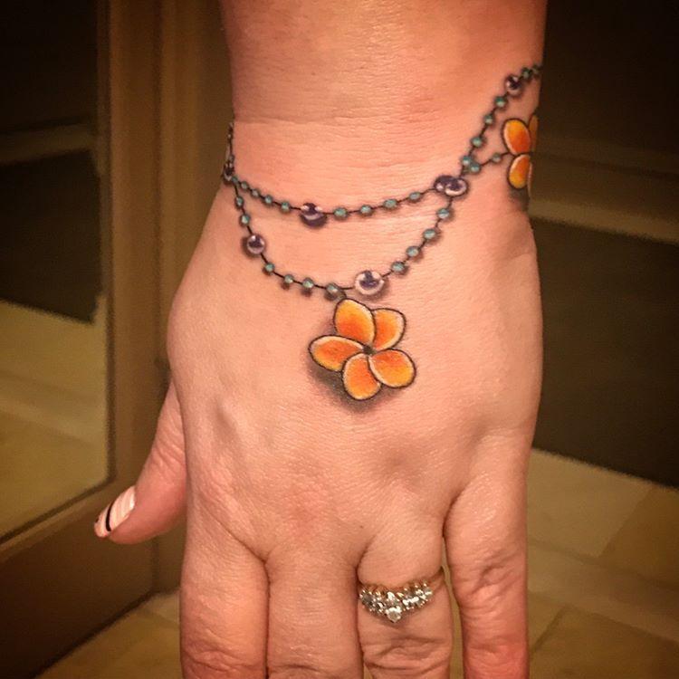 Bracelet Tattoo With Flowers Plumeria Bracelettattoo Plumeriatattoo Floraltattoo 45 Likes 8 Comment With Images Charm Bracelet Tattoo Tattoo Bracelet Plumeria Tattoo