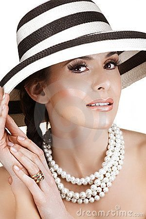Woman in straw hat  and pearls by Luba V Nel, via Dreamstime