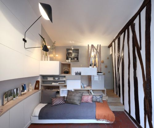 Parisian tiny apartment julie nabucet architecture france pull out seating humble homes