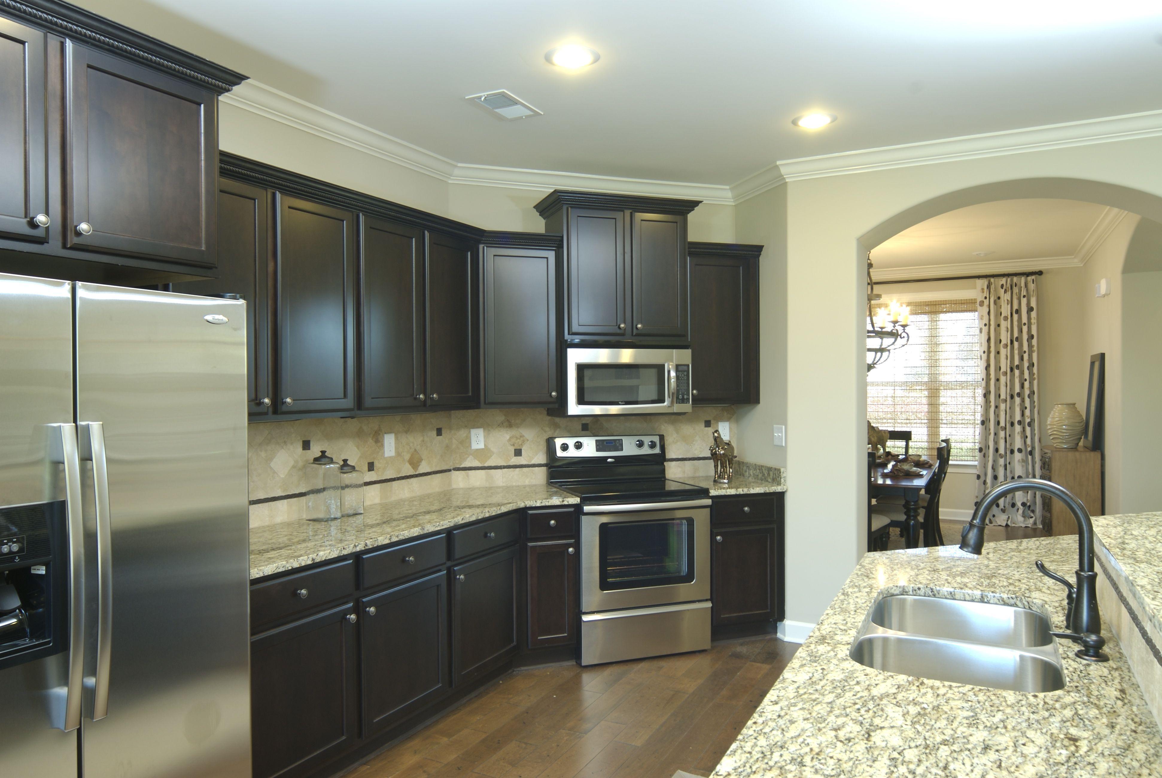 Regency Homebuilders : Open Concept Living And Kitchen, Dark Wood Cabinets,  Travertine Backsplash,