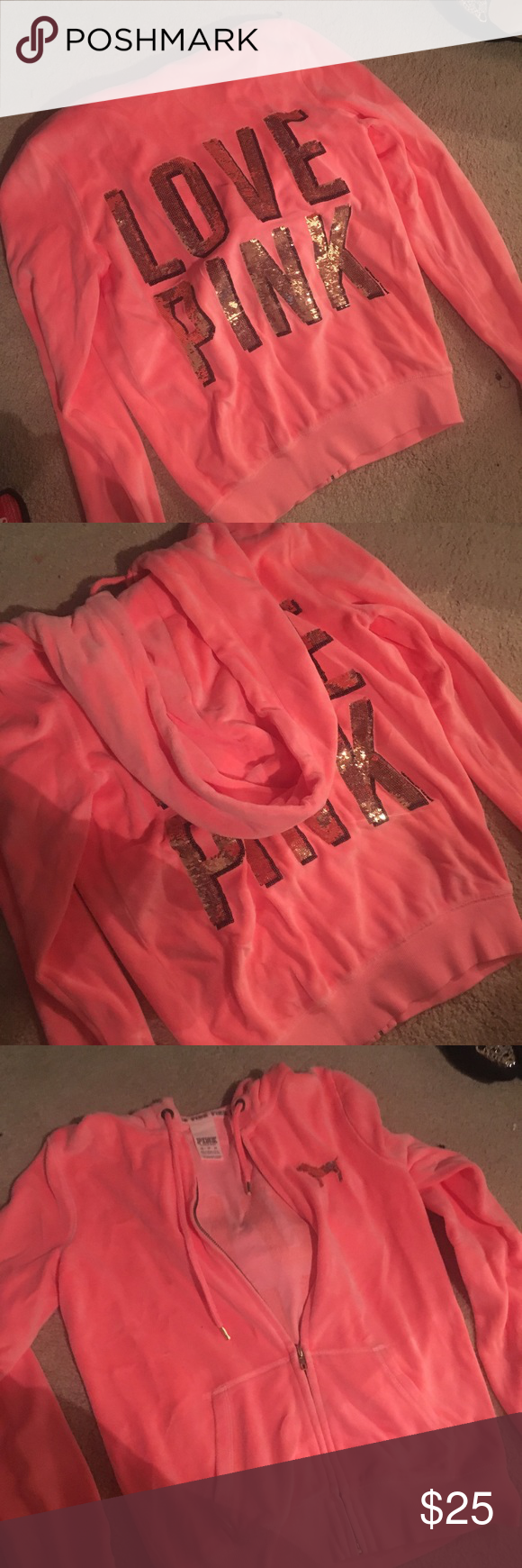 PINK by VS Zip Hoodie This zip up hoodie by Victoria's Secret pink is so pretty! It's in the perfect coral color with gold sequins on the back and a little on the front. It's been worn a few times and washed, but it's still in great condition and there areno signs of wear or any stains! It is a size extra small but these run a little bigger so a size small could fit in it as well. PINK Victoria's Secret Jackets & Coats