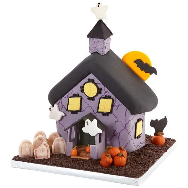 Family and friends will scream with delight when they see this happy Halloween haunted house cake. Decorate the scene using Wilton's Ready-To-Use Rolled Fondant, Stand-Up House Cake Pan and the Wilton Halloween Mini Cookie Cutter Set.