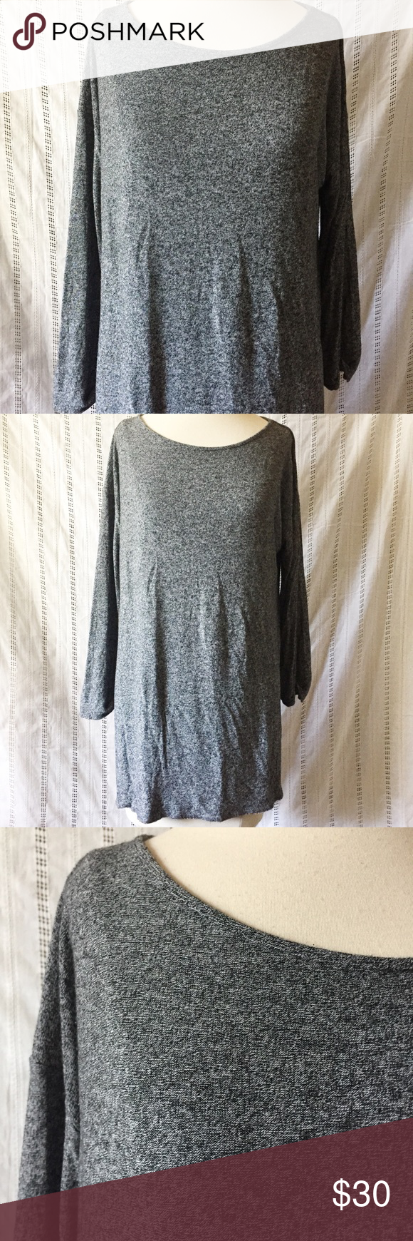 """J.Jill Wearever Collection Heather Gray Top Tunic J.Jill Wearever Collection Heather Gray thin top with 3/4 sleeves and Pleated back. Small. 95% rayon 5% Lycra  In excellent condition Measurements: Shoulder to shoulder: 23"""" Underarm to underarm: 28"""" Sleeve length: 17.5"""" Length: 27"""" J. Jill Tops Tunics"""
