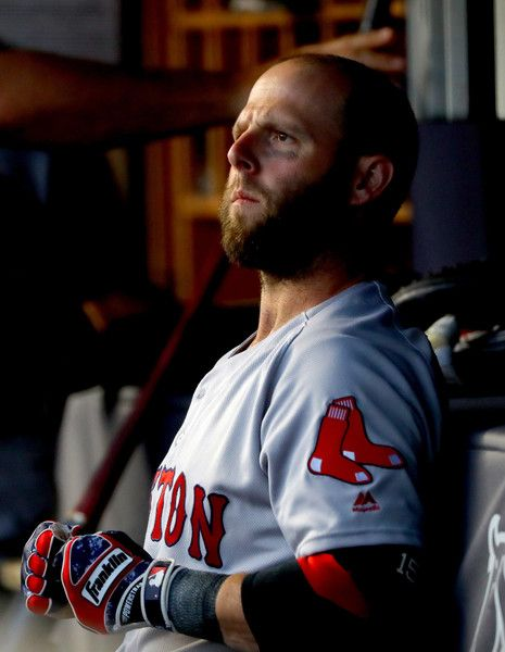 Dustin Pedroia Photos - Dustin Pedroia #15 of the Boston Red Sox looks on from…