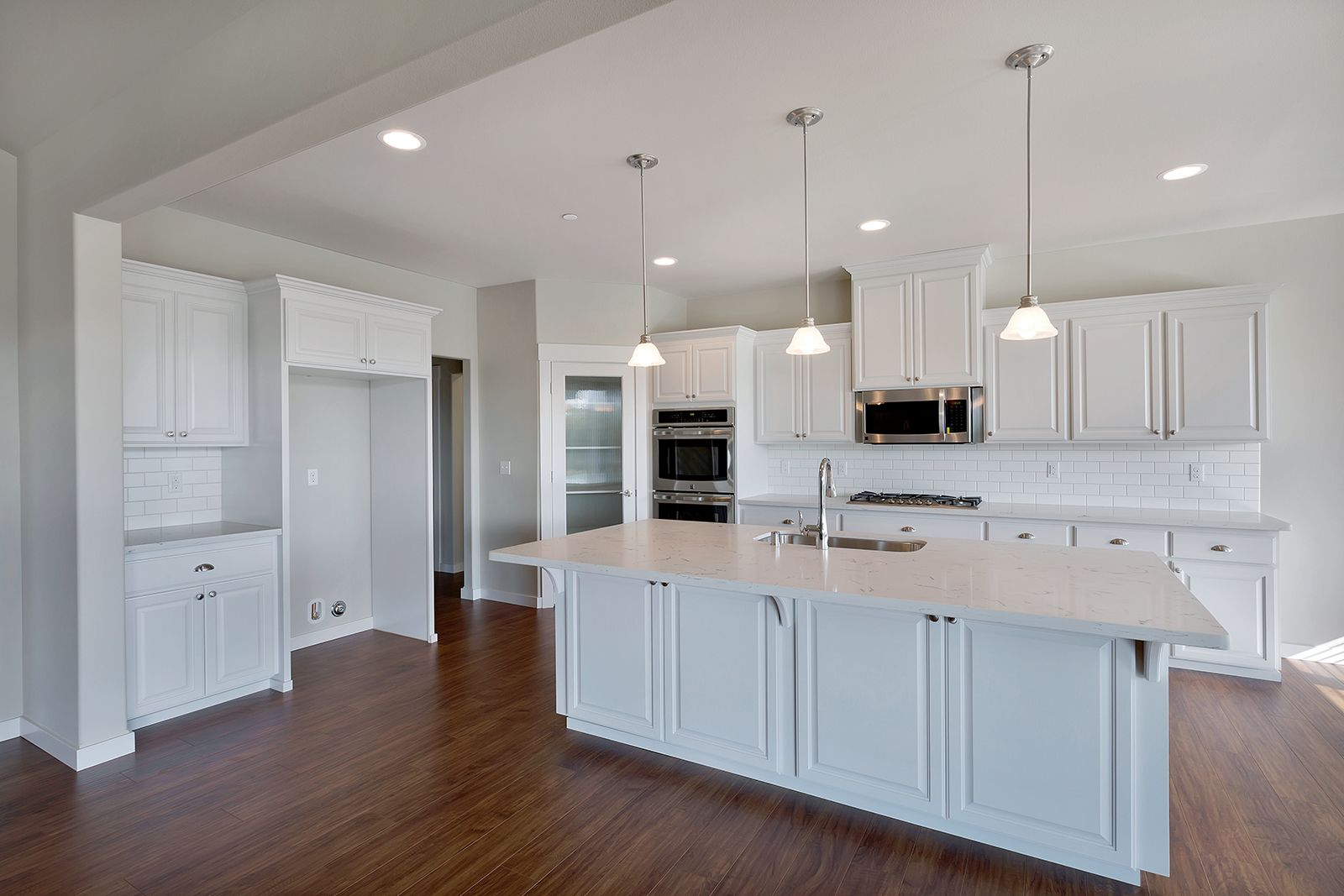 This exquisite classic style kitchen features white maple cabinets this exquisite classic style kitchen features white maple cabinets ohana quartz counters white subway tile backsplash with a medium gray grout and dailygadgetfo Images