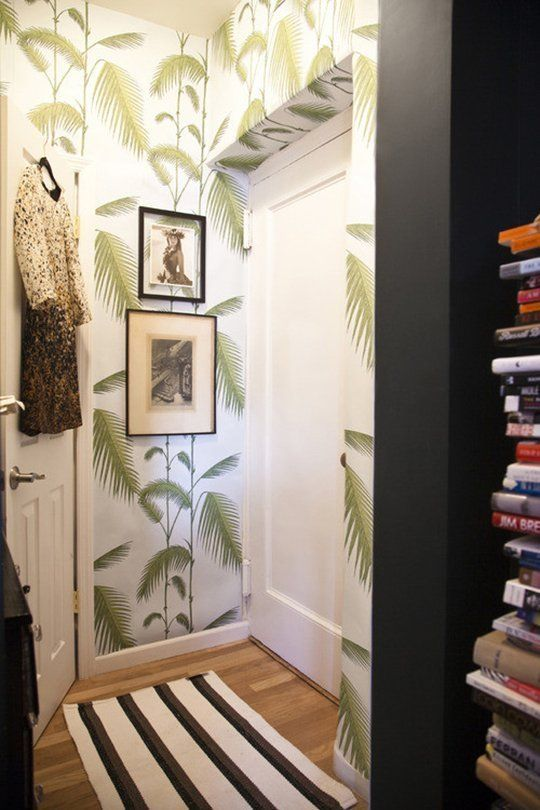 Small Entryway with Palm Leaf Wallpaper and Striped Rug