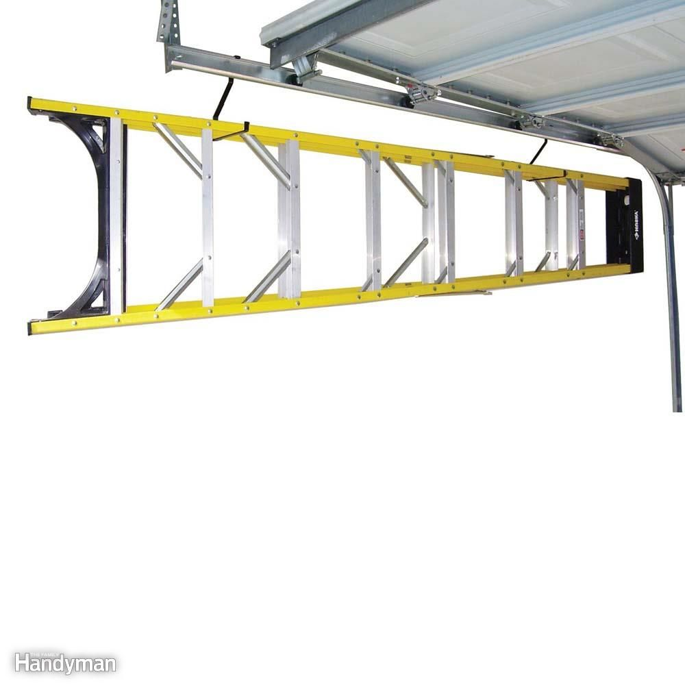 12 Simple Storage Solutions For Small Spaces Overhead Garage Storage Garage Storage Shelves Garage Storage Systems