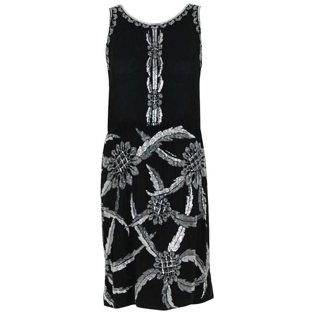 1920's French Black Graphic Floral Deco Beaded Silk Drop-Waist Flapper Dress   From a collection of rare vintage evening dresses and gowns at https://www.1stdibs.com/fashion/clothing/evening-dresses/