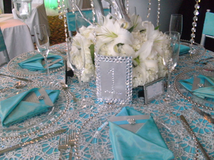 Bling and feathers for wedding ideas teal silver for Teal wedding theme ideas