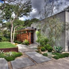 modern yard with large pavers, plants