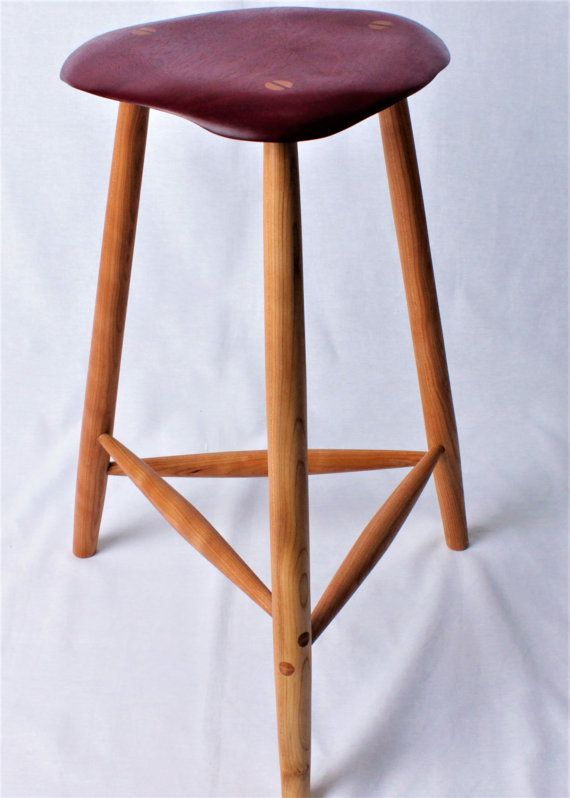 These barstools are modeled after the iconic Mid-Century Modern counter stools made by Wharton Esherick in the 1960s and 1970s. Minimalist, beautiful, and comfortable. Form and function are found in equal amounts with these wood bar stools. Wooden stools of this style made by Wharton Esherick typically sell at auctions for more than $10k each.  This listing is for one stool. The one pictured above has a Purpleheart seat with cherry legs.  The seats are made by free form carving their profile…