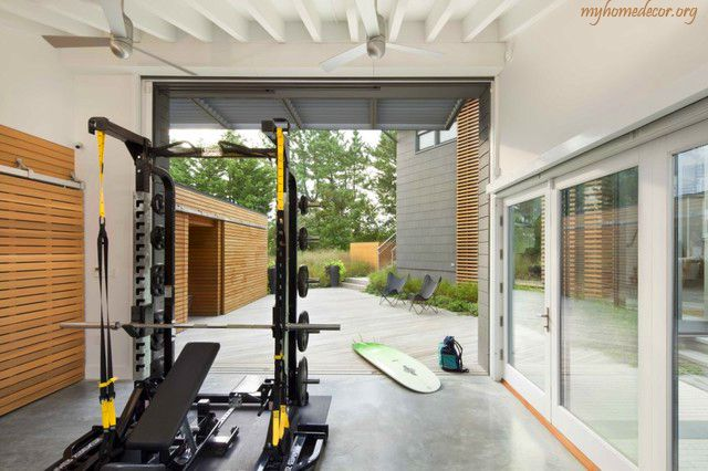 Modern home gym area self spotting bench squat rack
