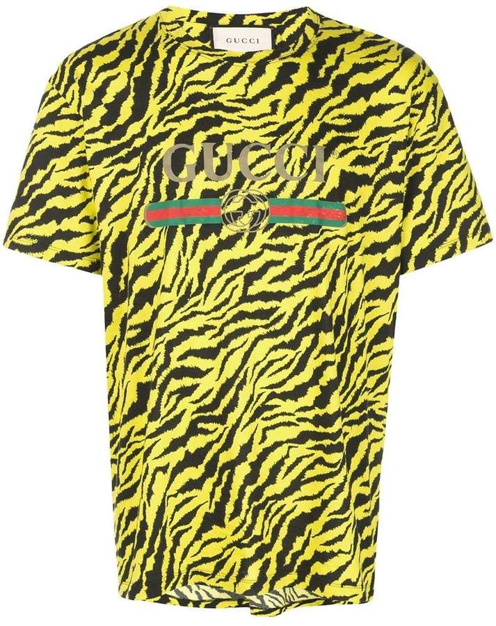 eb427ecd6 Gucci Fake Logo Zebra Print T-shirt in 2019 | Products | Gucci ...