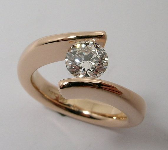 1 carat Canadian diamond tension set in Hand by WatertonJewelry