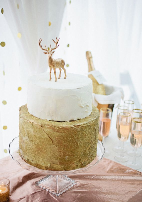 woodland wedding cake with deer topper