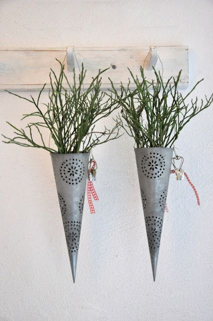 metall cones with greenery
