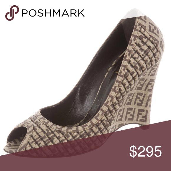 426f324f4ef0 FENDI Zucca Peep-Toe Wedges Flaunt your Fendi love with these brown and tan  zucca canvas peep toe wedges! Features smooth and quilted fabric