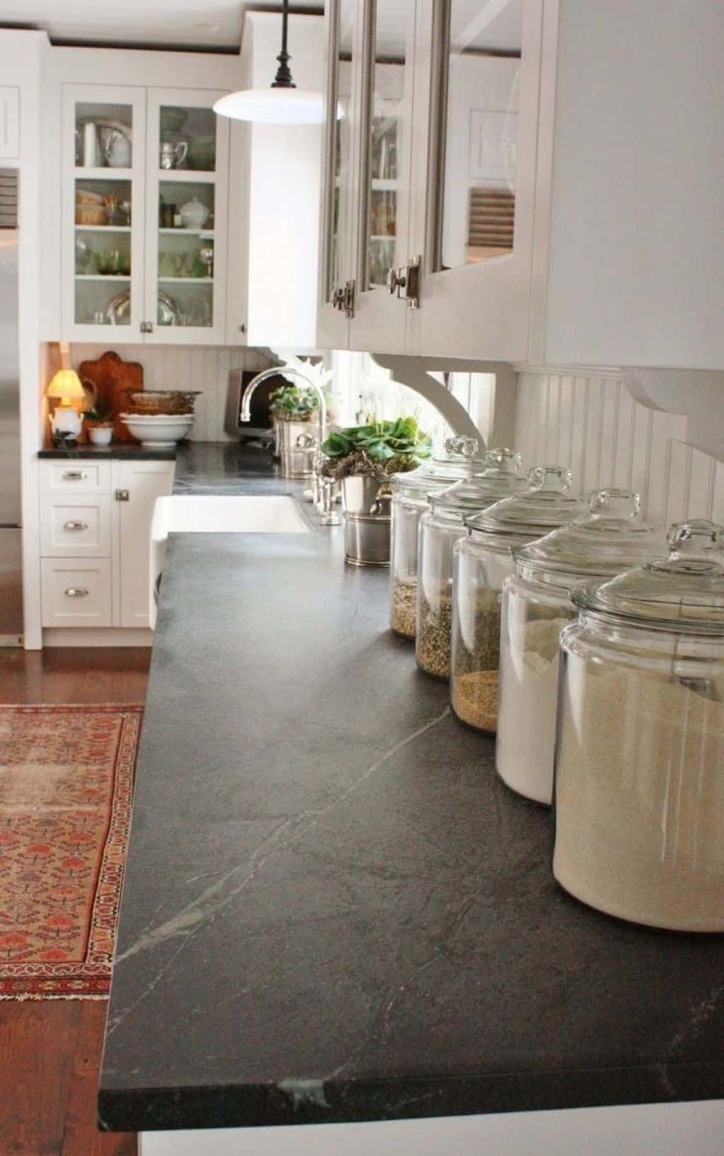 Country Kitchen With Soapstone Countertops And White Cabinets ...