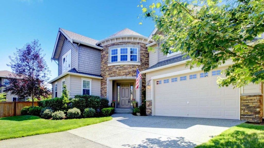 How Much Does It Cost To Replace A Garage Door Spring Garage Door Springs Garage Door Repair Garage Doors
