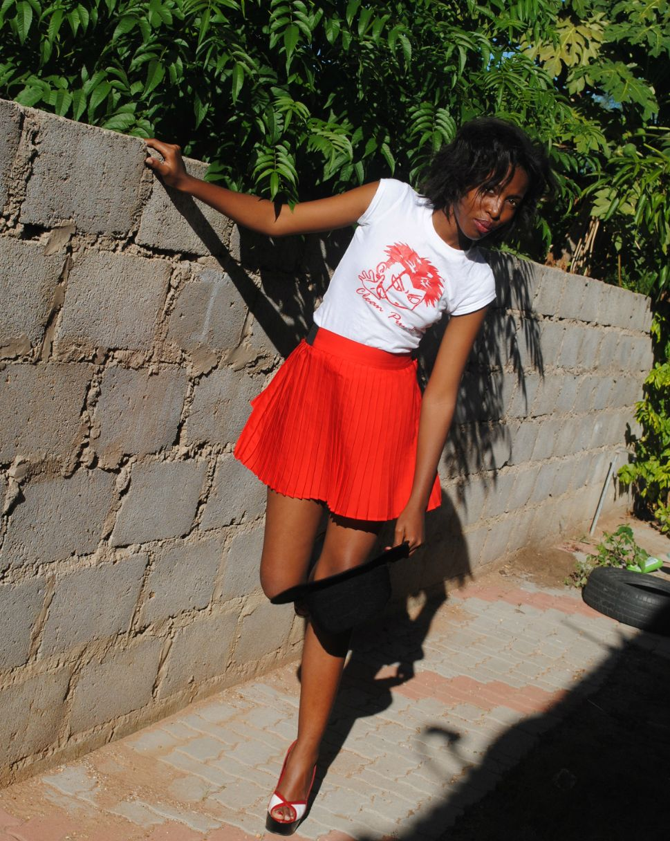 red skirt...graphic tee ..red black and white heels :)..me