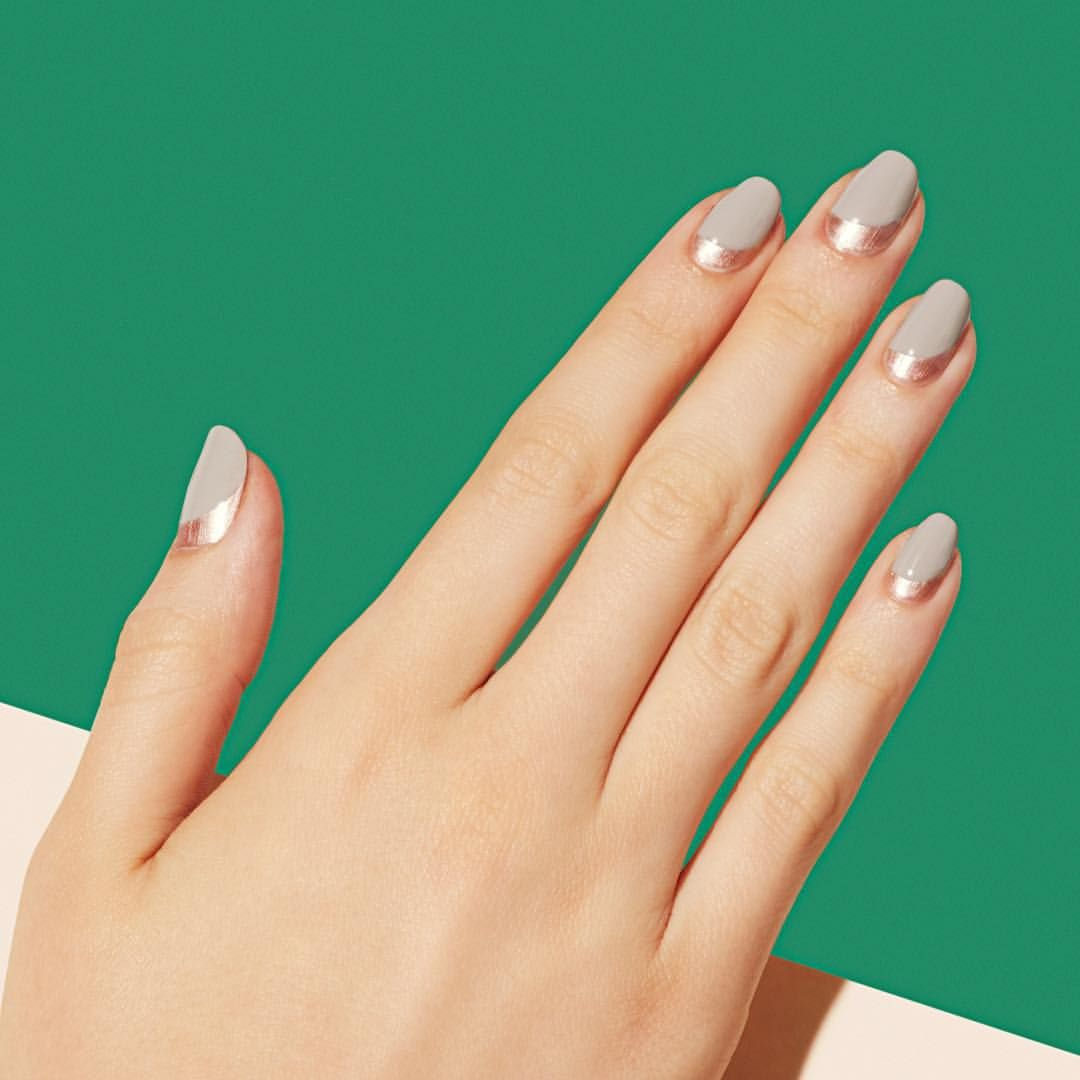 A bold swoosh of metallic helps a classic single-color nail look way ...