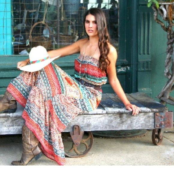 "Country Chic Strapless Maxi Dress This gorgeous maxi dress has the perfect ""country"" flair, with it's paisley print in browns, rust and turquoise. Add your own accessories for a cute bohemian,festival, or cowgirl look. Small fits bust up to size 36"". Available in Small(2-4), Medium (4-6). Model is 5'10"", wearing the size small. 100% polyester. Measures approx. 50"" from top to bottom. Fully lined from top to mid thigh. Detachable woven belt included. Super comfortable and soft! miss avenue…"